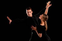 Ballroom Dancer Pair Dance Low Key on Black Background