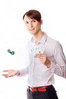 Man holding casino chips and four of aces on a white background