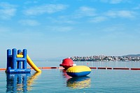 beach toys and equipment floating on sea Neos Marmaras Sithonia Halkidiki Greece