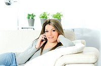 young beautiful woman on telephone in his sofa