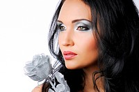Glamour woman with silver rose looking away