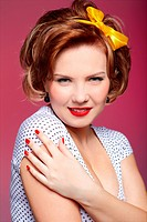 portrait of girl dressed and maked up in retro style