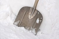 Close up of snow shovel