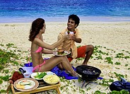 couple having a barbecue on Lanikai beach in hawaii