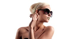 fashion portrait of young blond woman with hair style gold lips looking in one side with sun glasses