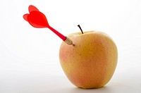 red arrow piercing an apple