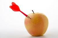 red arrow piercing an apple