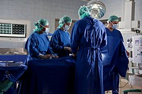 A surgery team operating on a patient in an operating room