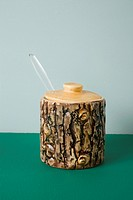 A ceramic honey jar made to look like tree bark