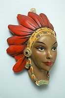A retro female mannequin wall hanging, Native American motif