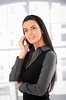Portrait of beautiful woman on call, using cell phone, smiling.