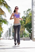 Girl jogging on pavement