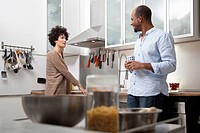 A couple standing in an apartment kitchen