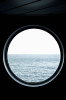 View of the sea through a porthole
