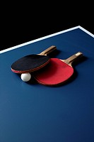 Table tennis bats and a ball on a table
