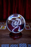 A crystal ball and tarot cards