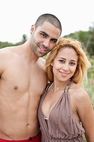 A young couple posing at the beach