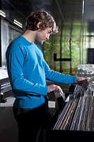 A young man shopping in a record store