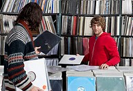 Two men shopping in a record store