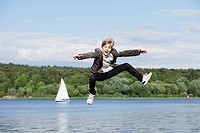 An adolescent boy jumping in the air