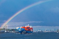 A rainbow over a shipping container in the Hamburg harbor