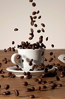 Coffee beans being poured into a cup