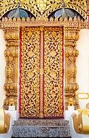 thai native ivy pattern gold door at wat thai,Chaingrai,Thailand