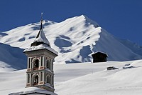 Church tower and snowy mountain in background