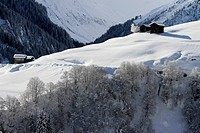 Winter landscape of mountain with log cabins (thumbnail)
