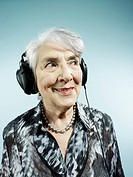 A senior woman wearing headphones (thumbnail)
