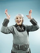 A senior woman with her arms raised in celebration (thumbnail)