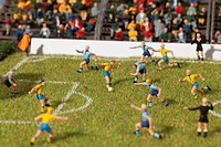 Miniature figurines of two soccer teams playing a soccer match (thumbnail)