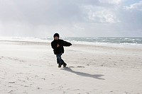 Boy running on the beach (thumbnail)