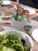 A jug of water and a glass on a dining table