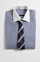 A folded shirt with a tie