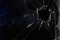 A window with a hole broken through the glass, night (thumbnail)