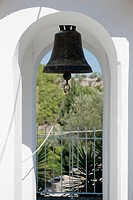 An old_fashioned bell hanging in an archway