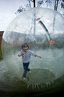 A young boy walking in an inflatable walking water ball (thumbnail)