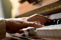 Piano chord pressed by woman's hand (thumbnail)