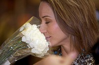 A close_up of a young woman smelling flowers, Pietermaritzburg, KwaZulu_Natal, South Africa