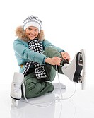 Smiling woman in winter style with skates. Isolated on white background