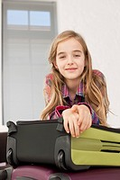 Germany, Leipzig, Girl with suitcase, smiling, portrait