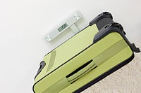 Germany, Leipzig, Heavy suitcase on scales in apartment