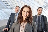 Germany, Leipzig, Business people on escalator, smiling, portrait (thumbnail)