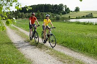 Germany, Bavaria, Man and woman riding bicycle (thumbnail)