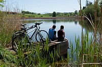 Germany, Bavaria, Man and woman sitting by bicycle