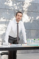Germany, Leipzig, Businessman with architectural model, portrait