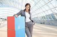 Germany, Leipzig, Businesswoman with cubes, smiling, portrait