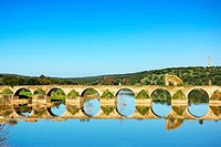 Old bridge of Ajuda in Guadiana river.