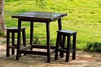 Black wood Table and chair located on the green garden